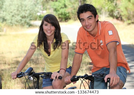 teenagers on a bike ride - stock photo