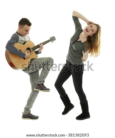 Teenagers playing guitar and dancing, isolated on white background - stock photo