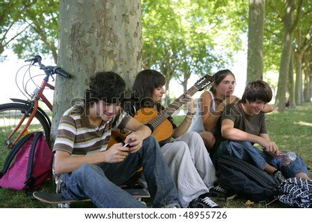 Teenagers playing the guitar - stock photo