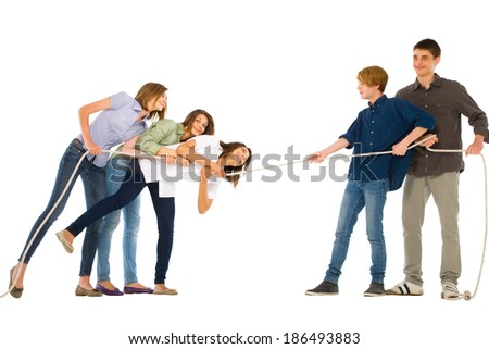 teenagers playing tug of wa - stock photo