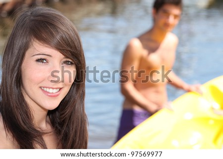 teenagers practicing surf - stock photo