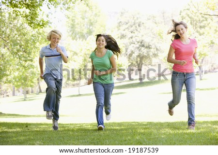 Teenagers Running Outside - stock photo