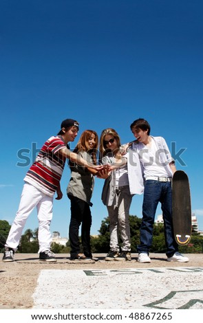 Teenagers stand by a street - stock photo