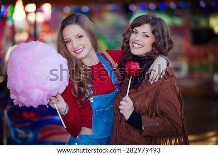 teens at fair with candy - stock photo