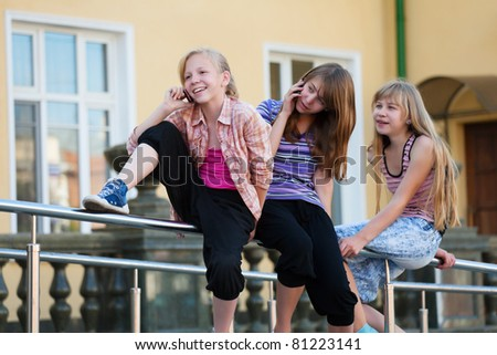 Teens calling on the mobile phones - stock photo