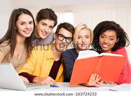 Teens. Education concept - students reading book at school - stock photo