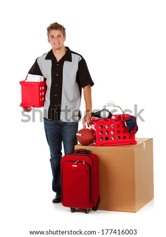 Teens: Guy Stands By His College Posessions - stock photo