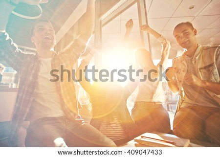Teens having fun together in cafe - stock photo