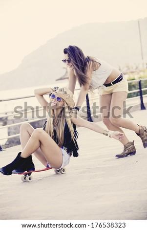 teens having fun with skateboard - stock photo