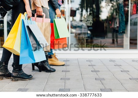 Teens with colorful shopping bags - stock photo