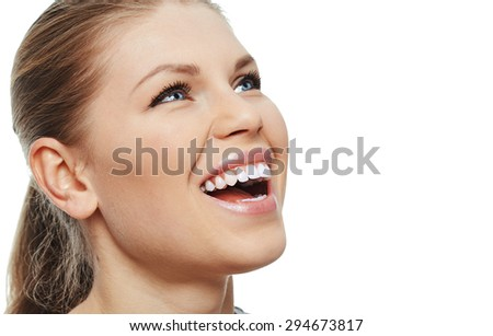 Teeth whitening and treatment. Close-up portrait of attractive Caucasian girl with perfect toothy smile isolated over white background. - stock photo