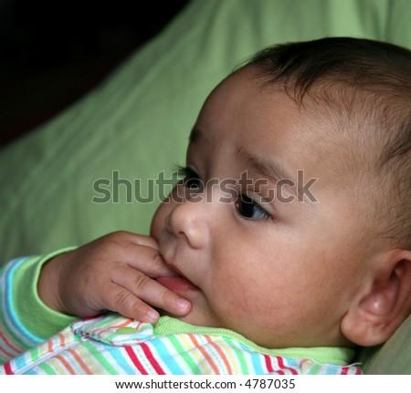 Teething baby - stock photo