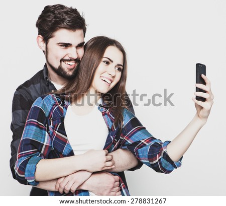 tehnology, internet, emotional  and people concept: Capturing happy moments together. Happy young loving couple making selfie and smiling.Special Fashionable toning.  - stock photo