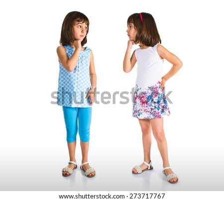 Tein sisters looking each other - stock photo