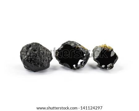 Tektite Meteorite isolated on white background - stock photo