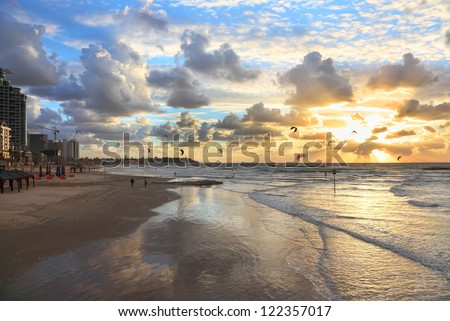 Tel-Aviv beach sunset view and kite surfing (Mediterranean sea. Israel) - stock photo