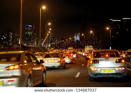 TEL AVIV - DEC 13:Heavy traffic on Ayalon road at night on December 13 2009 in Tel Aviv, Israel. Tel Aviv, accommodating about 500,000 commuter cars daily, suffers from increasing congestion. - stock photo