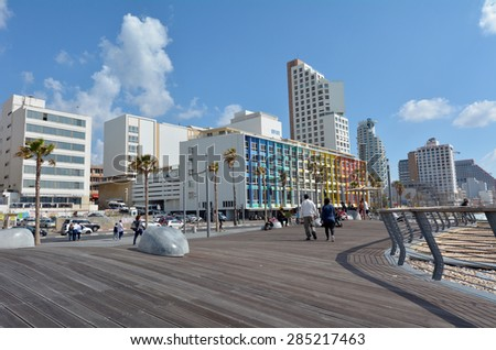 TEL AVIV, ISR - APR 07 2015:Tel Aviv promenade in Tel Aviv Israel.Tel Aviv is the financial capital of Israel and home to a major performing arts and business center. - stock photo