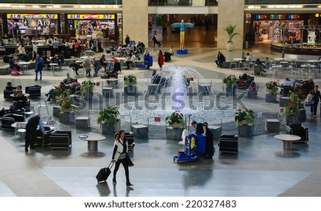 TEL AVIV, ISRAEL - FEBRUARY 13, 2014: Tourists and Israeli citizens waiting for their departures in Duty Free shops area in the Ben Gurion International Airport. - stock photo