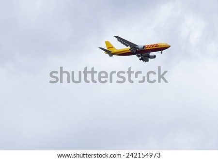 Tel-Aviv , Israel - January 3 . 2015 : A DHL Boeing 757 on approach on January 3,2015 in Tel-Aviv. DHL is Europe's largest cargo only airline and owned by Deutsche Post. It operates with 133 aircraft. - stock photo