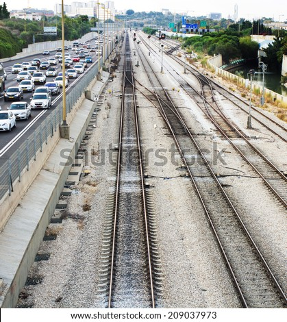 Tel-Aviv , Israel - July 28 . 2014 : View from the Bridge Street Halacha in a northerly direction. Tel - Aviv, Israel. Beautiful photos in a modern city on the railroad tracks and the freeway. - stock photo