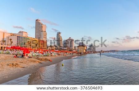 TEL AVIV, ISRAEL - JUNE 19, 2015: Panorama of the beach, riviera, hotels and long promenade along skyline shot from the marine. - stock photo