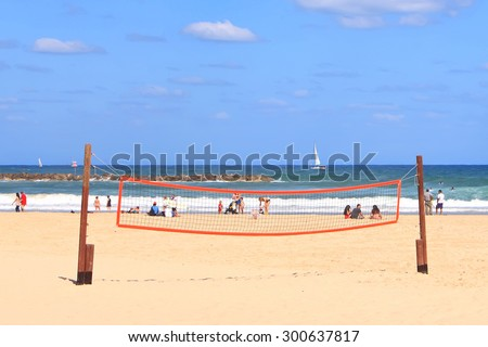 TEL AVIV, ISRAEL, JUNE 10, 2015 : Tel Aviv city public beach and people enjoying summer on Mediterranean sea. Tel-aviv beaches it's a lovely place for healthy activity for locals and visitors. Israel - stock photo