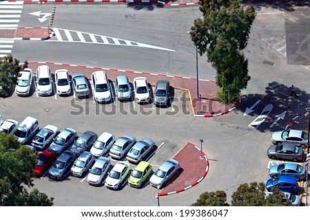 TEL-AVIV, ISRAEL - MAY 22 : Aerial view of full cars city parking on May 22, 2014 in Tel Aviv, Israel. The government has promoted park and ride to reduce traffic congestion - stock photo