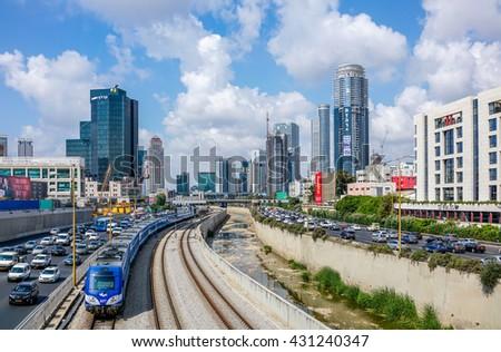 TEL AVIV, ISRAEL - May 20, 2016 : Ayalon high way and train railways over Ramat Gun  skyscrapers in Tel Aviv, Israel. - stock photo