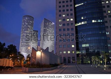 TEL AVIV, ISRAEL - MAY 10, 2015: Azrieli skyscrapers in Tel Aviv in evening - stock photo