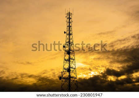 Telecom tower silhouette  in twilight sky background - stock photo