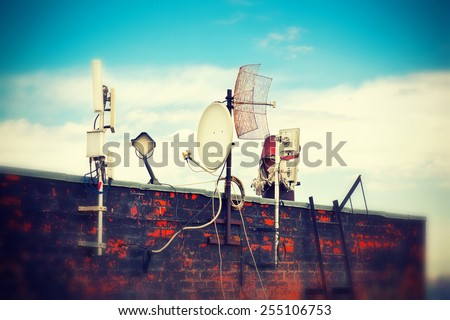 Telecommunication antenna on the roof - stock photo