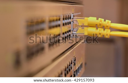 Telecommunication Ethernet Cables Connected to Internet Switch - stock photo