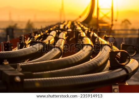 Telecommunication line connection on tower with sunrise sky. - stock photo