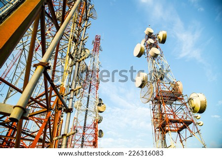 Telecommunication mast TV antennas with blue sky in the morning - stock photo