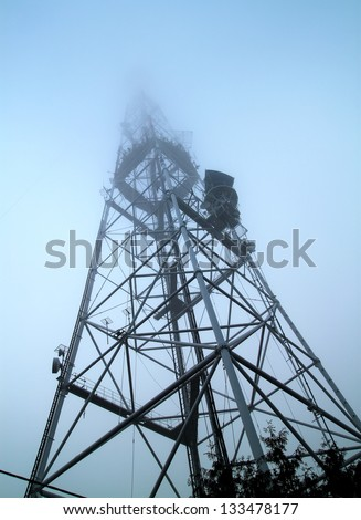 Telecommunication mast with microwave link and TV transmitter an - stock photo