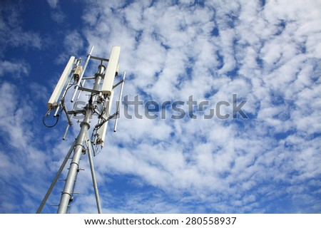 Telecommunication Radio Antenna Mobile Tower with clouds and blue sky - stock photo