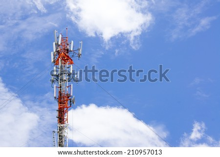 Telecommunication tower against cloudy sky - stock photo