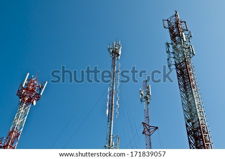 telecommunication tower - broadcasting steel telephone technology tall radar communication background blue - stock photo