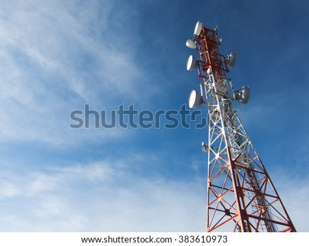 Telecommunication tower mast TV antennas wireless technology with blue sky - stock photo