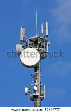 Telecommunication tower on blue sky - stock photo