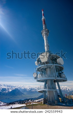 Telecommunication tower with a clear blue sky on the top of mount Rigi, Switzerland  - stock photo