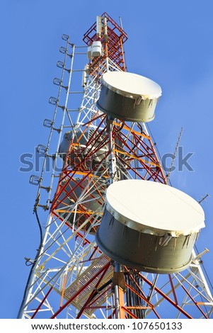 Telecommunication tower with antennas a blue sky. - stock photo