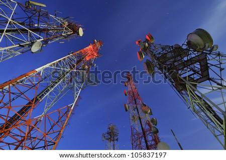 Telecommunication tower with night sky - stock photo