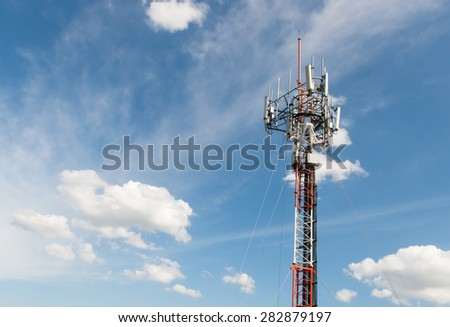 Telecommunications antenna for radio, television and telephone white cloud and Blue sky - stock photo