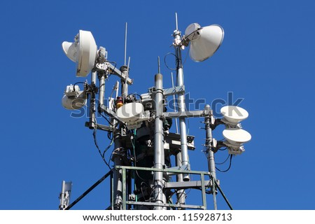 Telecommunications equipment - directional mobile phone antenna dishes. Wireless communication. - stock photo
