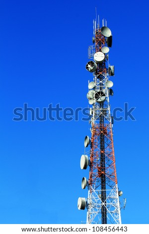 telecommunications tower with many satellite dish - stock photo