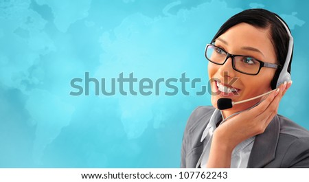 Telemarketing headset woman from call center smiling happy talking in hands free headset device. Business woman in suit in front of world map background. - stock photo