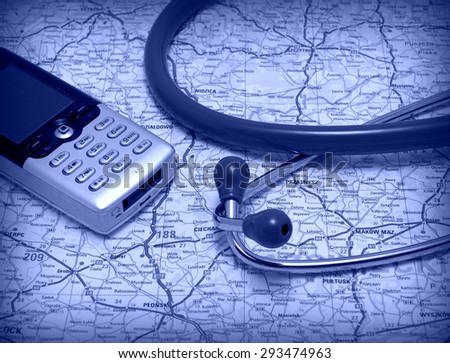 Telemedicine, telehealth set: Stethoscope and mobile phone on the public road map - stock photo