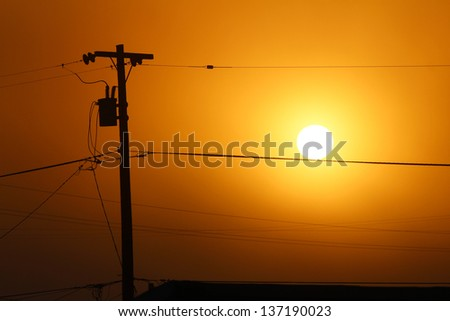 Telephone Pole and Wires at Sunset - stock photo